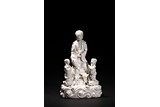 A BLANC-DE-CHINE FIGURE OF GUANYIN AND ATTENDANTS