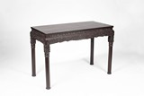 A CHINESE ROSEWOOD 'FLORAL SCROLL' CENTER TABLE
