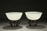 A PAIR OF WHITE JADE CARVED 'AMITABHA' BOWLS