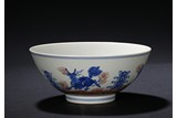 AN UNDERGLAZE RED BLUE AND WHITE 'QILIN' BOWL