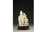 A WHITE JADE CARVED FIGURAL GROUP