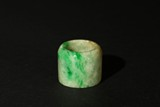 A JADEITE CARVED ARCHER'S RING