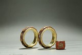 A PAIR OF GOLD-BEAD INLAID AGARWOOD BANGLES AND ARCHER'S RING