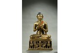A BRONZE ALLOY FIGURE OF SEATED BODHISATTVA