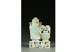 A WHITE JADE 'TAOTIE AND PLUM BLOSSOM' VASE GROUP