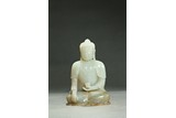 A WHITE JADE CARVING OF SHAKYAMUNI