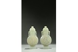 A PAIR OF CELADON JADE 'FIGURES AND BIRDS' MOONFLASKS