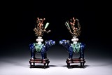 A PAIR OF BLUE GLAZED MYTHICAL BEAST SUPPORTING VASES
