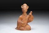 A RED CLAY POTTERY FIGURE OF A LADY MUSICIAN
