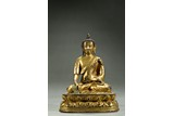 A GILT BRONZE FIGURE OF SHAKYAMUNI WITH INSCRIPTION
