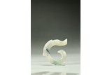 A SMALL ARCHAIC JADE CARVED DRAGON