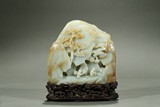 A WHITE JADE MOUNTAIN BOULDER