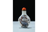 A WHITE AND CARAMEL OVERLAY GLASS 'FISH' SNUFF BOTTLE