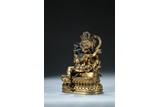 A GILT BRONZE FIGURE OF DEITY WITH CONSORT