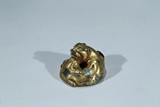 A GILT BRONZE 'TIGER' PAPERWEIGHT