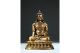A LARGE GILT BRONZE FIGURE OF SHAKYAMUNI