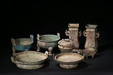 A SET OF EIGHT ARCHAIC BRONZE VESSELS