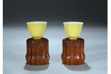 A PAIR OF LEMON YELLOW GLAZED CUPS WITH STANDS
