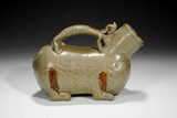 AN OLIVE GREEN GLAZED LION-FORM VESSEL,HUZI