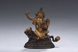 A COLD GILT FIGURE OF MANJUSRI