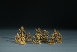 A GROUP OF TEN SMALL GILT BRONZE BODHISATTVA