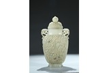 A LARGE AND THIN WHITE JADE MUGHAL-STYLE 'LOTUS' VASE