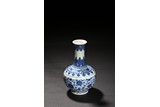 A BLUE AND WHITE 'LOTUS' BOTTLE VASE