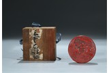 A CINNABAR LACQUER 'FIGURES' CIRCULAR BOX AND COVER