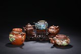 A SET OF FIVE YIXING ZISHA TEAPOTS