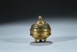 A SMALL GILT BRONZE TRIPOD CENSER