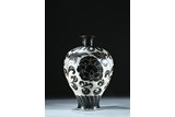 A BRONZE WHITE GROUND BLACK FOLIATE SCROLL DECORATED VASE