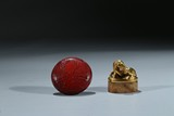 A GILT BRONZE HORSE SEAL AND A CINNABAR LACQUER BOX