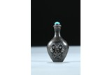 A SILVER CARVED 'FLOWER BASKET' SNUFF BOTTLE.