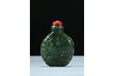 A SPINACH GREEN JADE 'DEER' SNUFF BOTTLE