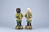 A SET OF TWO SANCAI 'FOREIGN BOY' FIGURES