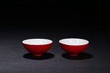 A PAIR OF RED GLAZED BOWLS