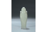 A WHITE JADE CARVED ARCHAISTIC VASE AND COVER