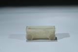 A CELADON JADE CARVED 'TAOTIE' CART-FORM COLLECTOR'S BOX