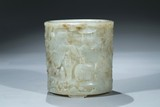 A LARGE WHITE JADE CARVED 'ELEPHANT' CYLINDRICAL BRUSHPOT