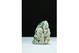 A JADEITE CARVING OF HEHE ERXIAN