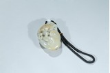 A WHITE JADE 'LINGZHI AND BAT' PENDANT