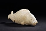 A MARBLE CARVED MODEL OF FISH