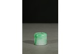 A JADEITE CARVED THUMB RING
