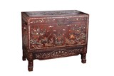A ROSEWOOD CARVED GEMS INLAID SCROLL TRUNK