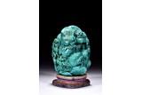 A TURQUOISE CARVED 'DEEP MOUNTAIN' BOULDER