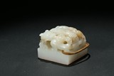 A WHITE JADE CARVED 'CHILONG' SEAL