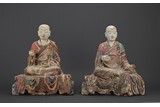 A PAIR OF LARGE POLYCHROME CLAY ARHAT FIGURES