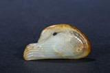 A WHITE AND RUSSET JADE CARVED GOOSE