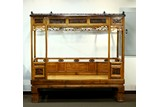A HUANGYANGMU CARVED SIX POST CANOPY BED