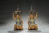 A PAIR OF CHINESE CLOISONNE ENAMEL 'FOREIGNER' CANDLESTICKS